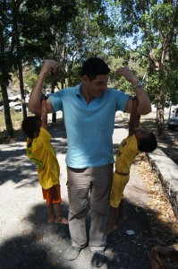 [Macquarie Telecom's George Drouvalakis makes friends easily with young Balibo locals]