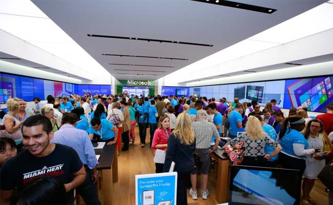 Photo of a busy Microsoft retail store