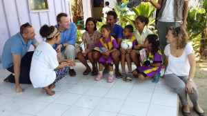 [CEO David Tudehope, the Macquarie Telecom team and ETHF volunteer Ana talk to Evangelina and her family outside the Bairo Pite Clinic]
